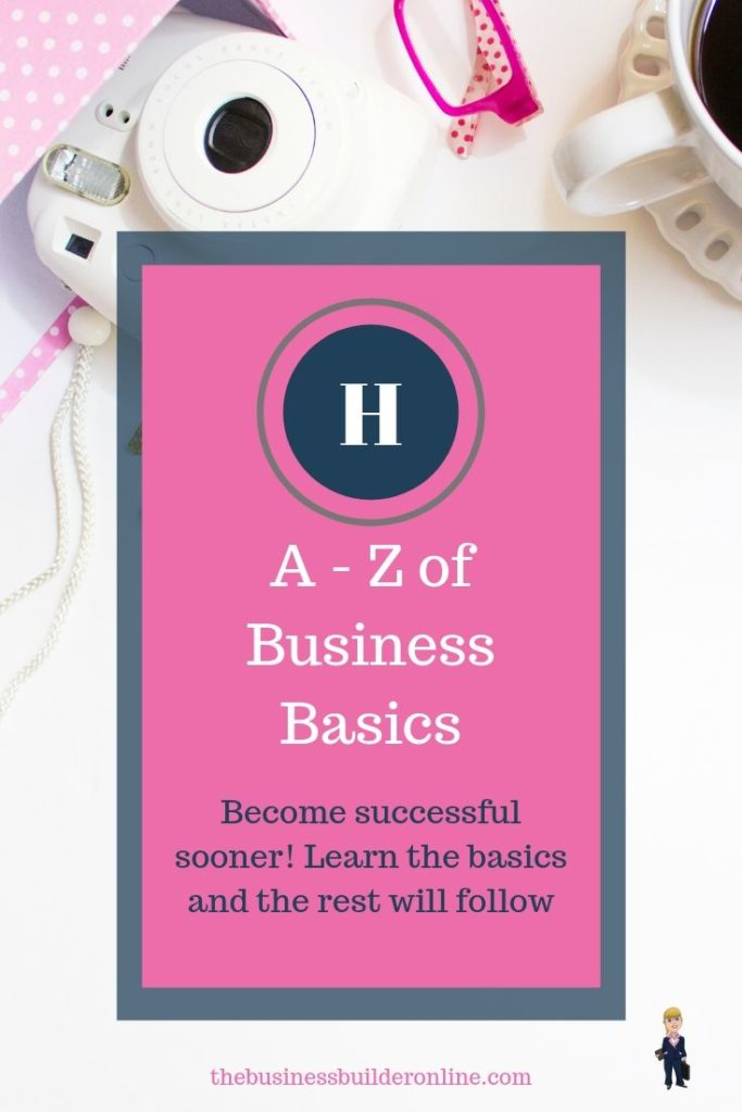 Image of white desk with pink trinkets with text overlay A - Z of Business Basics H